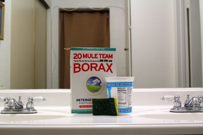 I use borax the most in the kitchen and in the bathroom. In the bathroom, I always have some borax stored in a container (as you can see we reuse in our household) and a sponge handy. With borax, a sponge, and some water, it takes me less than five minutes to clean our bathtub spotless.