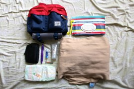 When on my own with the Nuggets, I try to pack as light as possible without leaving any necessities behind. In my fanny pack, I carry a changing pad, wipes, hand cream, chapstick, a pen, fingernail clippers, a couple of diapers, and my wallet. I carried Z Nugg in the Moby wrap to make it easier to travel.