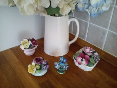 ceramic flowers 10-50p each!
