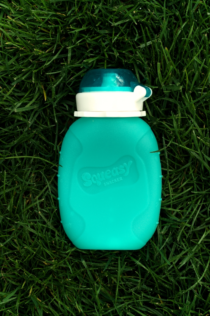 squeasy reusable pouch in the grass