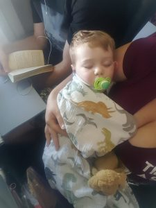 toddler sleeping on airplane-toddler flight-first plane ride-flying with children