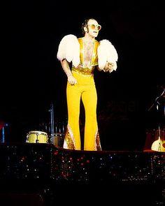 google images elton john yellow jumpsuit
