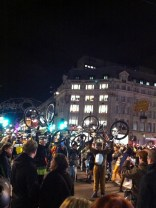 Some crazy protest thing happening at the intersection of Regent Street and Oxford Street. Everyone was dressed up (could be Halloween related) and lifting up their bikes...