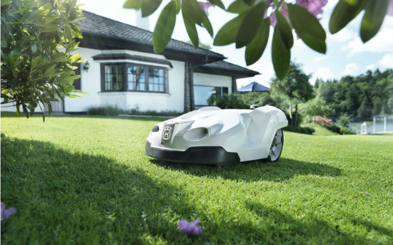 Robot lawn mower in the garden