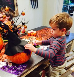 Cooper decorating his pumpkin