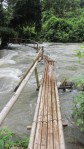 Waters raging from the rainy season and a rickety bridge to cross...