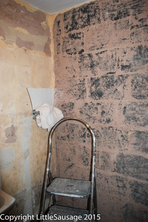 Plaster gone from the wall.