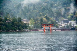 Floating torii gate in the distance.