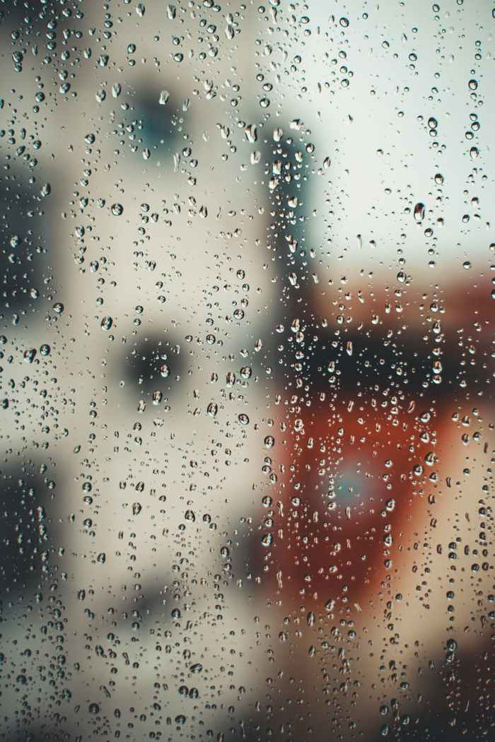 abstract background with raindrops on misted glass