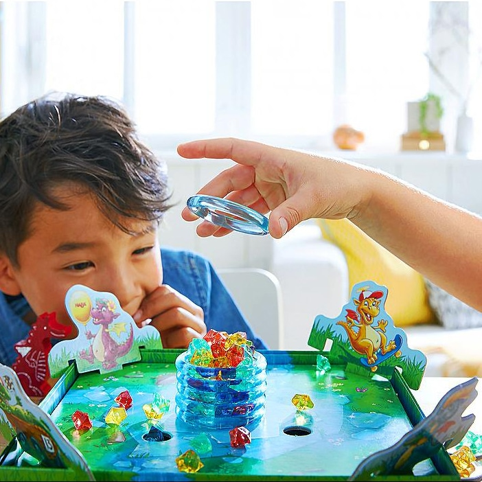 educational toys - children playing haba board game