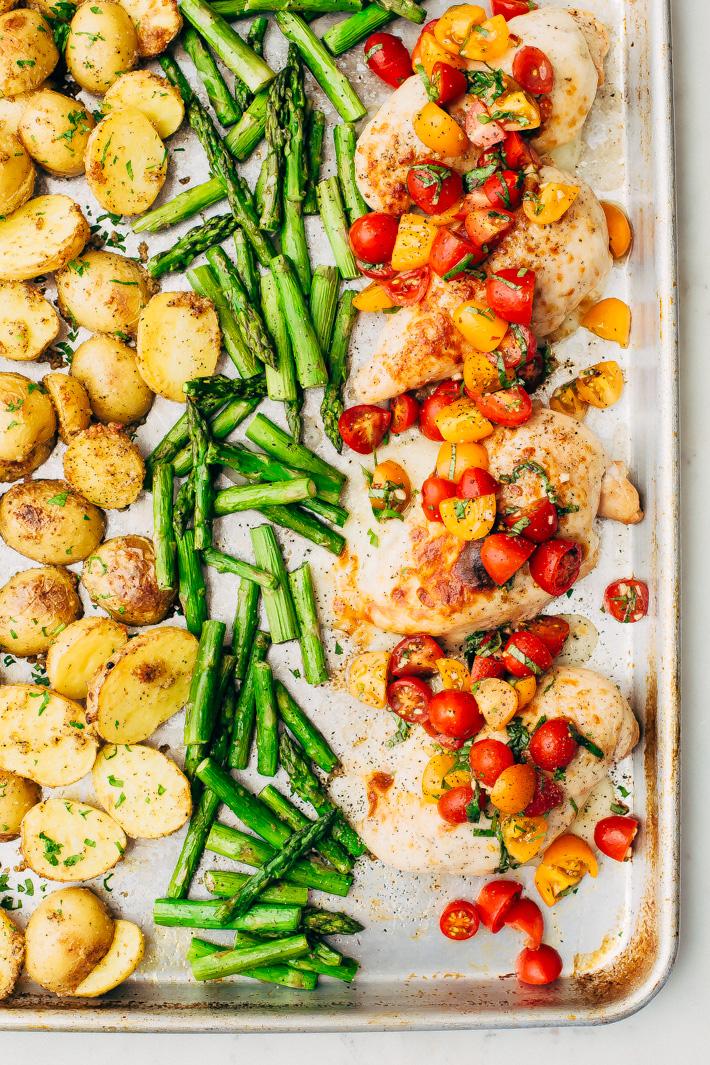 Sheet Pan Bruschetta Chicken with Potatoes and Asparagus - make a healthy, nutritious dinner all on one sheet pan! #bruschettachicken #roastedchicken #chickenbreast #bruschetta | Littlespicejar.com