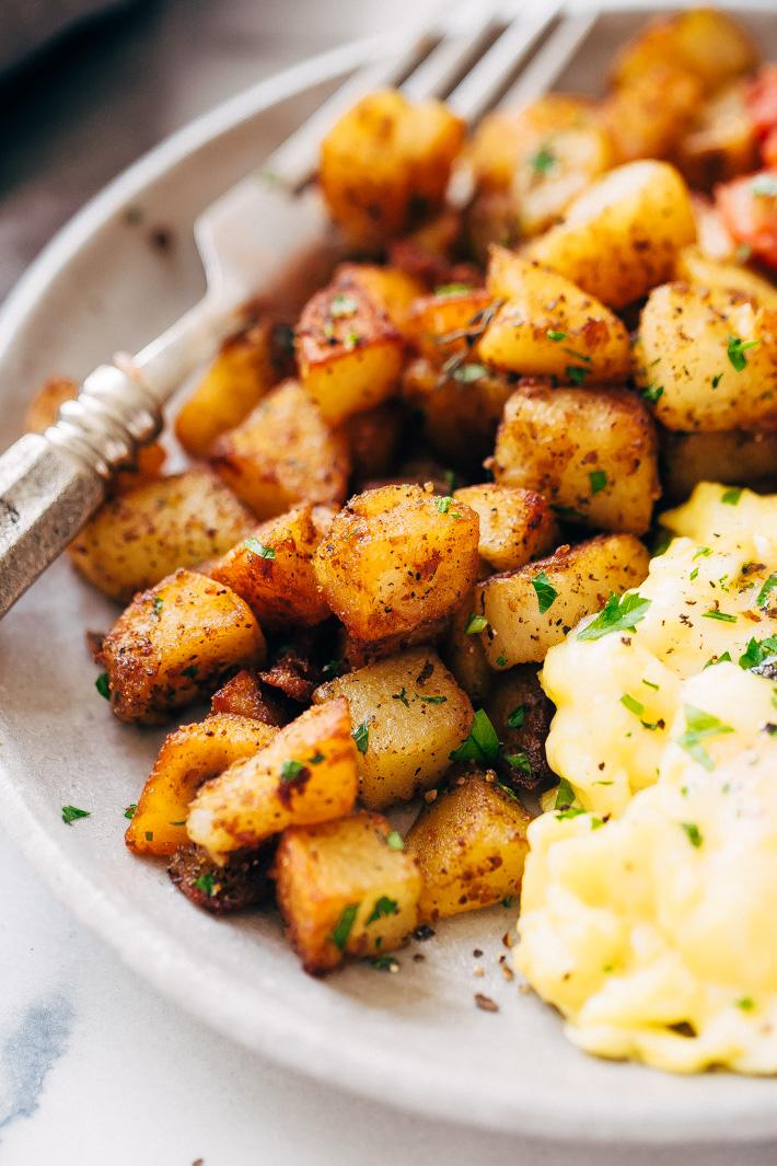 Easy Skillet Breakfast Potatoes - lightly crispy on the outside, tender on the inside. These breakfast potatoes are sure to be a hit! #skilletpotatoes #breakfastpotatoes #crispypotatoes | Littlespicejar.com