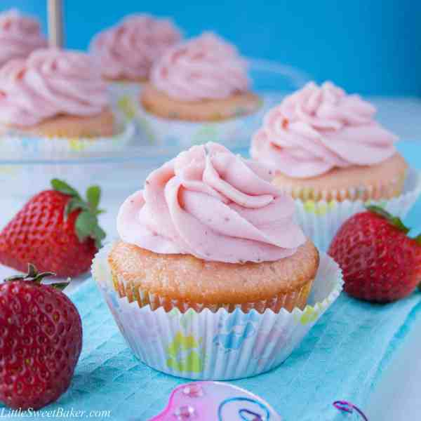 Pink Velvet Cupcakes with Strawberry Buttercream. Moist, fluffy and buttery vanilla cupcake with a strawberry reduction buttercream.