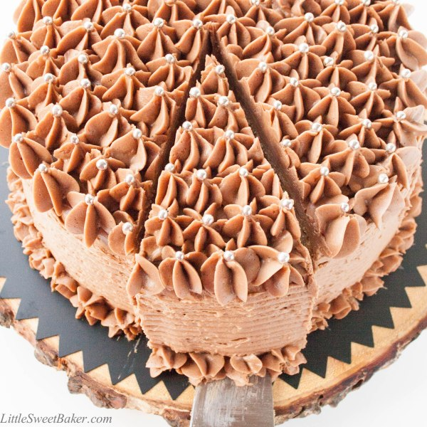 BANANA CHOCOLATE CHIP CAKE WITH MILK CHOCOLATE FROSTING. A deliciously moist chocolate chip banana cake surrounded with a real milk chocolate buttercream.