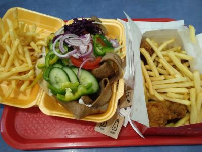 Foood - Image shows a kebab, chips, salad and chicken wings.