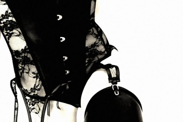 an image of me in a latex corset for an image titled pale