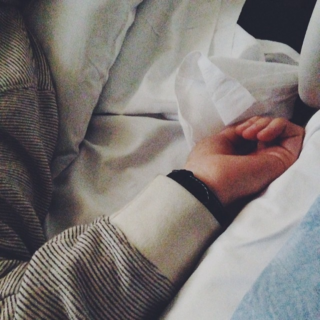husband beside me in the hospital bed