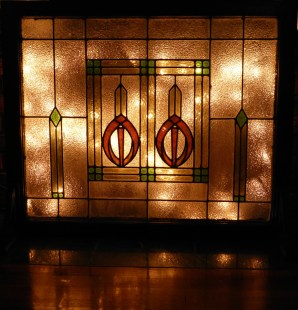 stained glass fireplace screen with Christmas lights behind