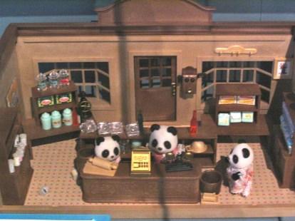 Tiny pandas running a shop