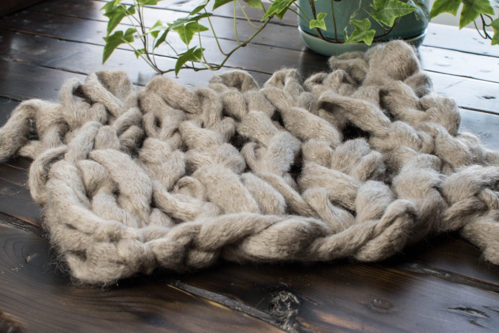 Arm knitting swatch of chunky yarn