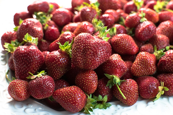 a pile of fresh bright red strawberries