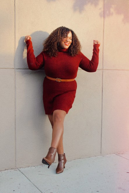 Burgundy sweater dress on woman with curly hair