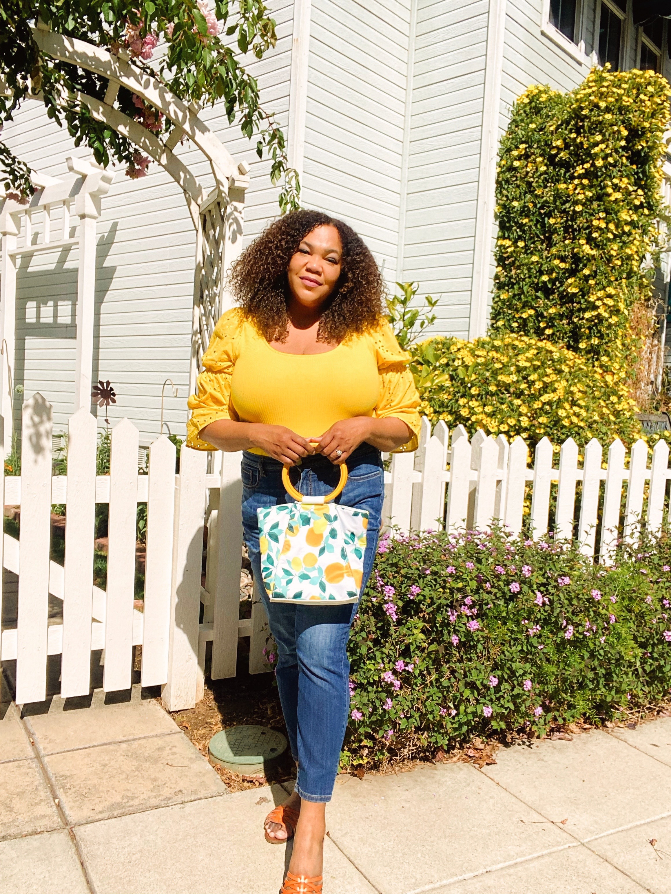 A black woman in a yellow top