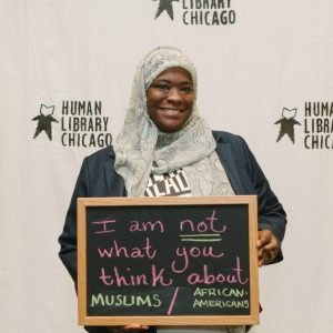 "A ""Book"" (as storytellers in the human library are called), poses at an event in Chicago. Courtesy of Human Library Chicago."