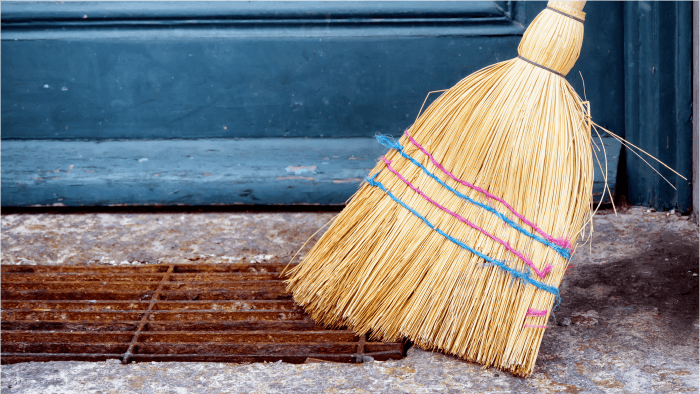 a broom sweeping the sidewalk holiday traditions