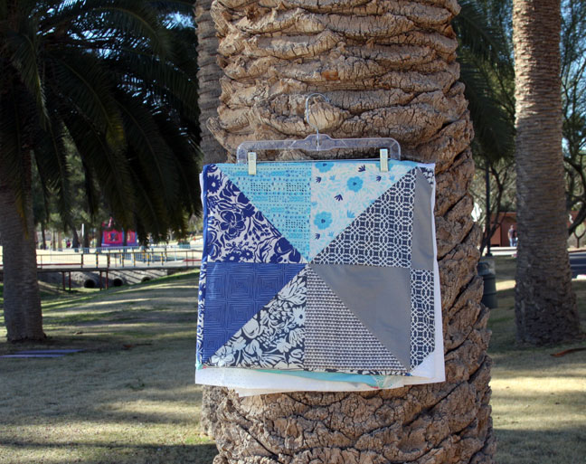 folded quilt on palm tree