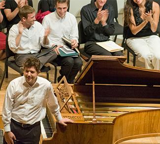 Photo of Nick Mathew by piano