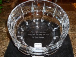 The chorus presented Marika Kuzma with a clear glass bowl engraved wtih