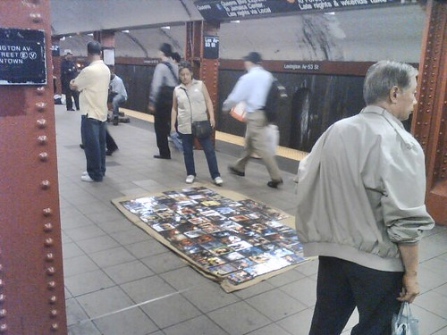 Counterfeit DVD's for sale at Lex-53rd station