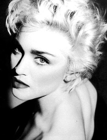 Madonna photograph of her posing naked on a bed while