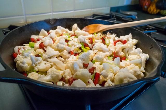 sautéing the leek, cauliflower, and swiss chard