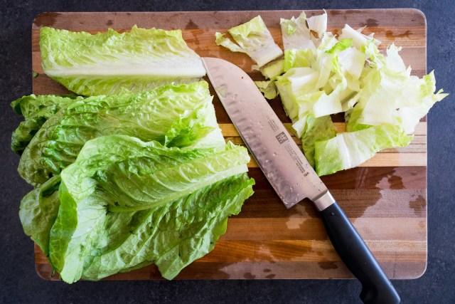 chopping the crisp romaine lettuce