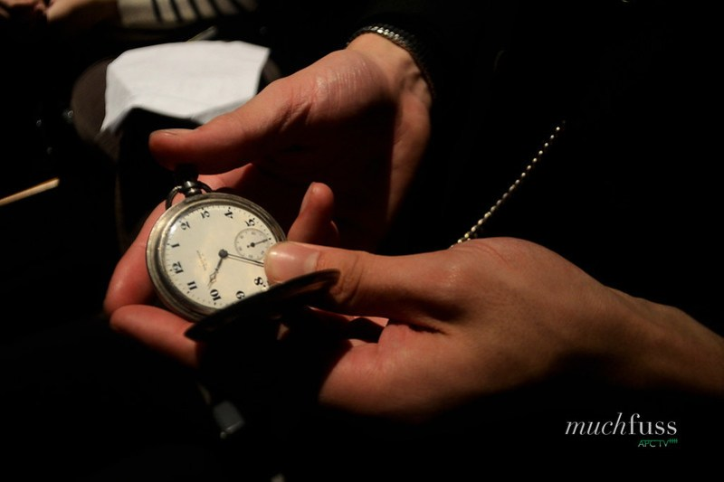 Adrian checking his pocket watch