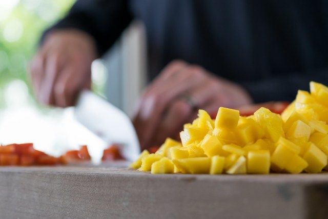 dicing mangoes and peppers