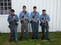Photo of living historians in Civil War era uniforms