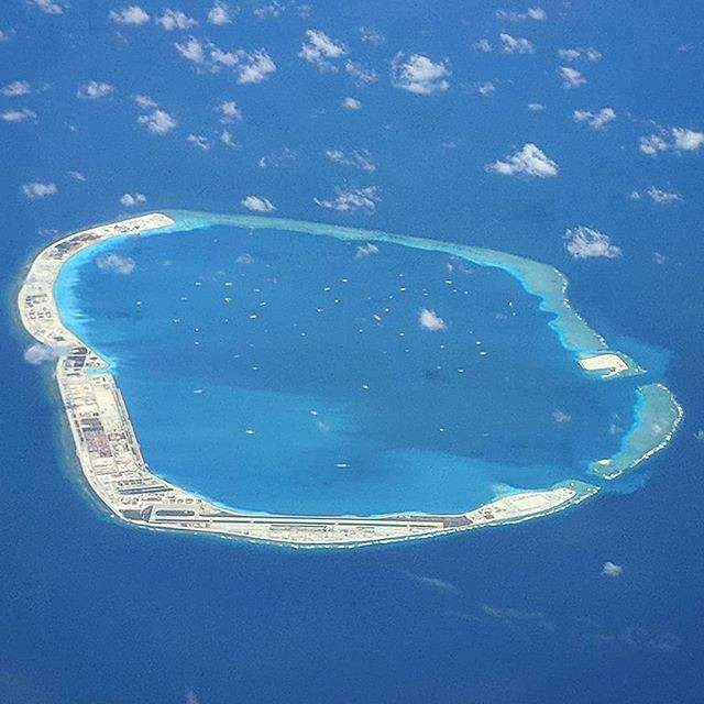 One of the militarized islands by China off the coast of Philippines. Been on the lookout for one of these each time I have flown over the area and this time managed to spit and capture from the plane window. This one is Panganiban Reef (Mischief Reef) in