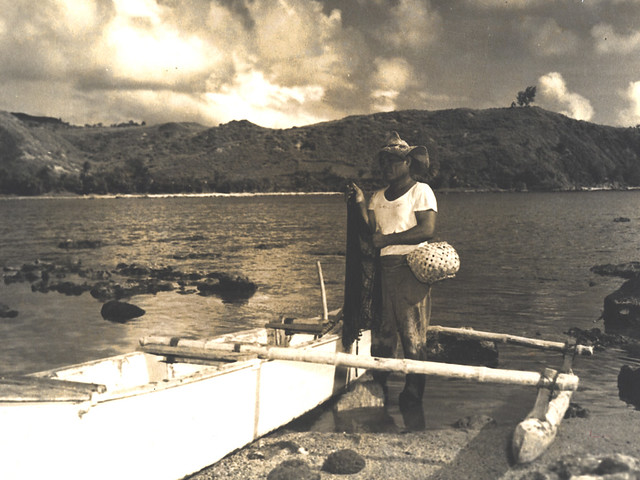 Fisherman and Outrigger Canoe