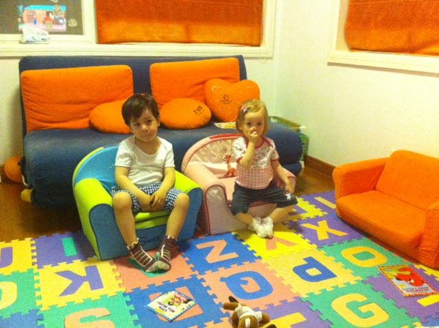 Back home after busy day, kids are watching TV in their play room