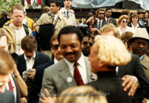 P019.134m.r.t March on Sacramento 1988 / Pre Parade gathering: Jesse Jackson walking through a crowd