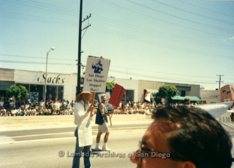 """P341.042m.r.t Charles McKain marching with a sign that reads """"San Diego: Lou Sheldon Stopped Here!"""" (Steven Pope in background)"""