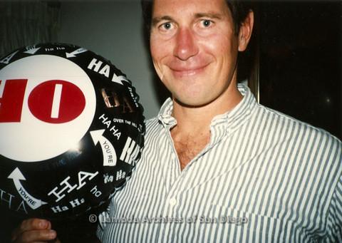 P099.007m.r.t John's 40th birthday: John holding a 40th birthday balloon