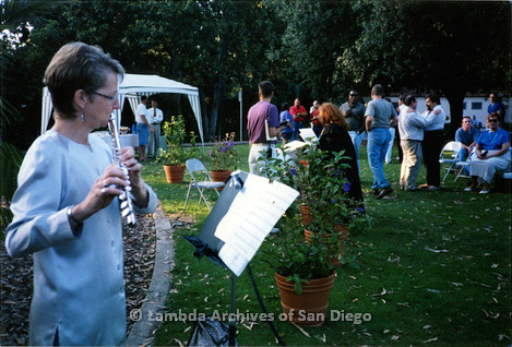 P198.007m.r.t GLAAD Sponsored Commitment Ceremony: Sharon Parker playing flute outdoors in Balboa Park