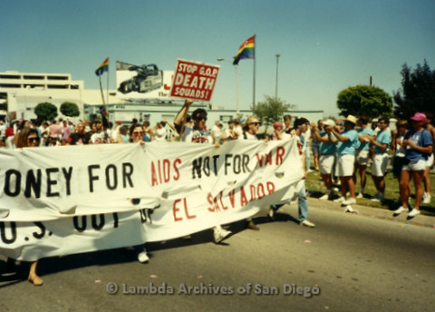 """P341.040m.r.t A group walking in LA Pride Parade holding a sign reading """"Money for AIDS not for War U.S. our of El Salvador"""""""