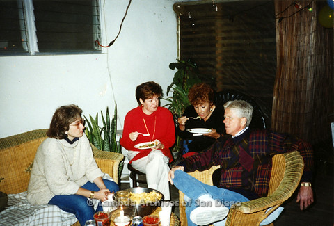 P099.048m.r.t A man and three women sitting and eating at a party