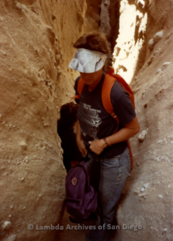 P008.083m.r.t Anza-Borrego Desert 1984: Mary Russell squeezing through a tight pass