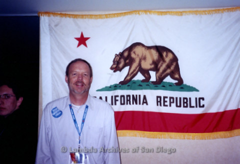 P338.037m.r.t 2000 Democratic National Convention Los Angeles: Charles McKain standing in front of California State Flag